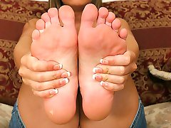 Dirty blonde cutie has her sexy red painted toes licked and sucked