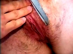 Girl gets her dark natural hairy pussy shaved and finger fucked