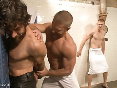 Hot leather daddy Dirk Caber heads into the local gym to relax in the sauna when two curious...