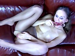 Nasty girl gets to nylon foot tease and solo anal on the large leather sofa