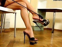 Busty blond beautys stiletto heels almost pierce through slaves soft skin