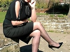 Gorgeous blonde Demi catches some sun out and about, wearing a pretty black blouse and skirt,...