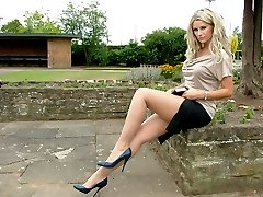 Gorgeous blonde Kathryn flashes her sexy long legs and naughty white panties, whilst racing your pulse wearing blue stilettos
