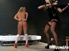 New girl Ashley Coda gets turned into a little lesbian pain slut by Nika Noire. At first she is...