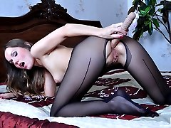 Teasing hottie boasts feet in reinforced sole tights while stuffing her ass