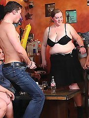 The horny big girls with talented mouths give great blowjobs to the guys in the pub