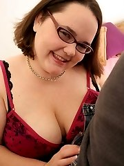 Mature bookworm having her huge tits pinched and squeezed