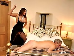 Mistress Carly pleasures herself on the bed until her slave arrives with the dildo mask! Then...