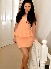 Nicola strips from her peach dress to reveal her panties under nylon pantyhose