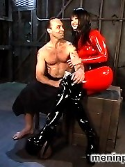 Pro-Dominatrix, Mistress Aradia, tears into her fresh meat, training him in latex worship,...