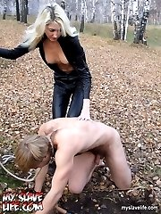 Sexy blonde in leather outfit makes her slave spring a hole