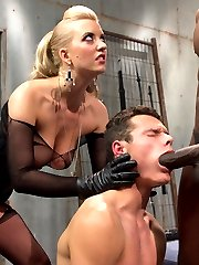 Cherry Torn always has young little play things on the side. Mickey is her new toy and totally worships her. Cherry called me up and asked if I would mind setting up a little cuckolding surprise for her naive slave. Mickey was caught totally of guard and Cherry had to bring in a little punishment to get him to submit. Once we got him in chastity and I brought in beautiful bull, Jason Brown, Mickey had nothing to do but make his mistress happy and suck that big black cock getting it all nice and huge and hard for Cherry's lily white perfect pussy! Jason's big load drips off Cherry's beautiful pussy lips and she sits right on top of Mickey's face hand feeding him the only thing he's eating for dinner.