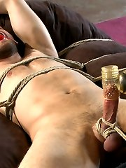 Abel Archer is a hot bisexual stud coming to us completely fresh to bondage and edging. We start him off in the center of the room tied to each column. We get him hard through his underwear before cutting them off to reveal his fat cock. With his hands bound he\'s made to watch as we tease him with our fingertips. While sucking on the head of his cock we blindfold him and bring him to the edge of cumming again and again. He\'s bent over and the dildo up his ass makes precum ooze out of his cock. Fully suspended, and raging hard, we bring him to the edge again as Abel begs to cum in Sebastian\'s mouth. Tied to a bean bag we fuck his ass some more and finally allow him to shoot his load all over himself. He moans and begs for us to stop jerking his sensative cock after his orgasm so we tickle him in the tight bondage instead.