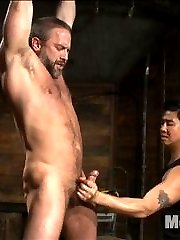 Van and John Jammen wheel in hot muscled stud, Dirk Caber as hes bound with duct tape around his...