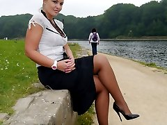 Lovely Karen is on her break and enjoying a bit of sunshine in her silky nylons and her black...