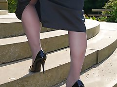 Lovely Sara is outdoors posing in a pair of silky nylon stockings and stunning black stiletto heels