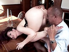 Carolyn Pierce spreads wide on the kitchen table and wraps her sexy bare feet on a huge dick