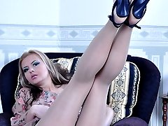 Bigtitted babe takes off sexy spike heels to show her sleek nyloned soles
