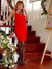 Lady in red showing off her legs in classy black stockings stuffing a toy