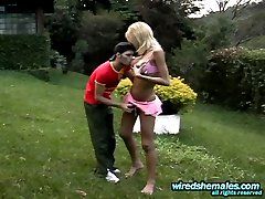 Tanned shemale having surprise under her short skirt for a guy to gobble on