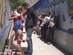 Susy Blue is just thrilled to be disgraced in public.  Parading through the streets of Madrid with her tits and ass on display, Steve Holmes and Mistress Jasmine take turns smacking Susy's pussy, ass, and tits with floggers and canes.  Steve face-fucks Susy until a crowd gathers and a lucky bystander gets his dick sucked.  Later inside a restaurant, Steve humiliates Susy with the help of the customers.  Susy blue ultimately gets fucked by Steve and Mistress Jasmine and swallows two massive loads from Steve and a young stud.