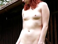 This redhead cutie has masturbated outdoors before, but never in the middle of a front lawn like...