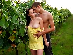 Between the rows of the grape plants, these horny teens undress each other. Soon, her lips are...