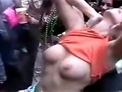 Sexy blonde girl flashing her tits for beads during Mardi Gras