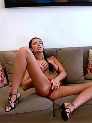 Luscious brunette Hana stripping her skirt and rubbing pussy on the couch