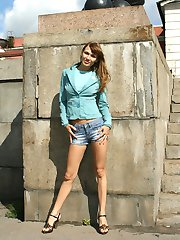 Seductive fem in tight jeans shows her ass