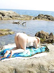 Spy cam secretly capture nude moist slits and huge boobs on the beach