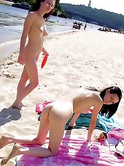 A pair of nudist teen friends steam up the beach