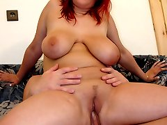 Big breasted redhead sucks cock and swallows cum!
