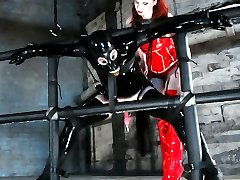 Claire Adams has a new toy named rubberboy.  He comes complete with operating manual,  full rubber wardrobe, an assortment of enormous ass toys, and a submissive demeanor conducive to the most sophisticated, sadistic palate.  Miss Adams wastes no time in stretching his ass with a huge, electrified ass plug that firmly confirms his status for the day.  Hooded and enclosed in rubbber, he is then worked through several positions that leave him vulnerable and available to the delightfully twisted dominatrix, and she takes full advantage by whipping, slapping, squeezing and fucking his ass with the largest strapon we have ever seen here at MIP.