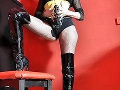 Female Dom Strap On Dildo Jane plays with her huge strapon cock clothed in fishnets, boots and yellow corset