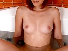 Saucy redhead plays with pussy