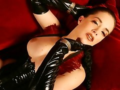 High heeled horny latexmistress