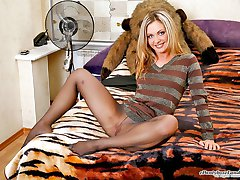 Blonde chick slipping into her grey pantyhose and working her itchy pussy