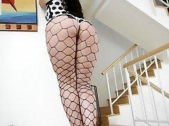 Kristina Rose in vinyl polkadot underwear and fencenet tights