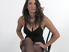 Watch Nylon Jane slowly and seductively put her sexy stockings on her very smooth silky long legs