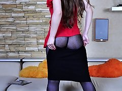 Hot dame dresses for a party admiring her glittery animal print stocking