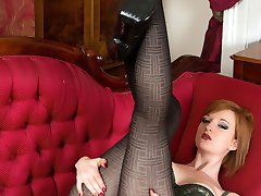 Our slinky natural redhead cavorts here in some unusual black texture hose, pulling them tight in the crotch!