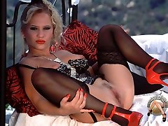 Young pornstar posing in undergarments with stocking garters and black stockings