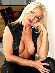 Busty cougar Casey Szilvia exposes shaved pussy.
