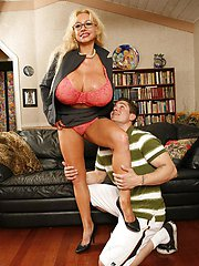 Blonde MILF Echo Valley wears a high healed shoes while riding a massive cock in a sofa