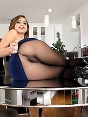 Gorgeous girl in black seamless pantyhose on the table