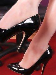 Dara the secretary in shiny and sheer pantyhose