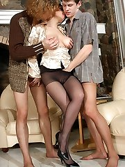 Vivacious black-haired playing with rocky fuck-sticks clad in pantyhose in wild 3some