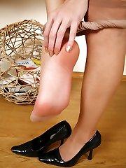 Long-legged brunette hikes up her skirt examining sheer hosepipe before changing them