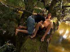In the middle of the woods, this bubbly teen takes off her clothes and feel his cock growing hard inside of jeans. She soon unzips his cock and takes it out so that she can have it.